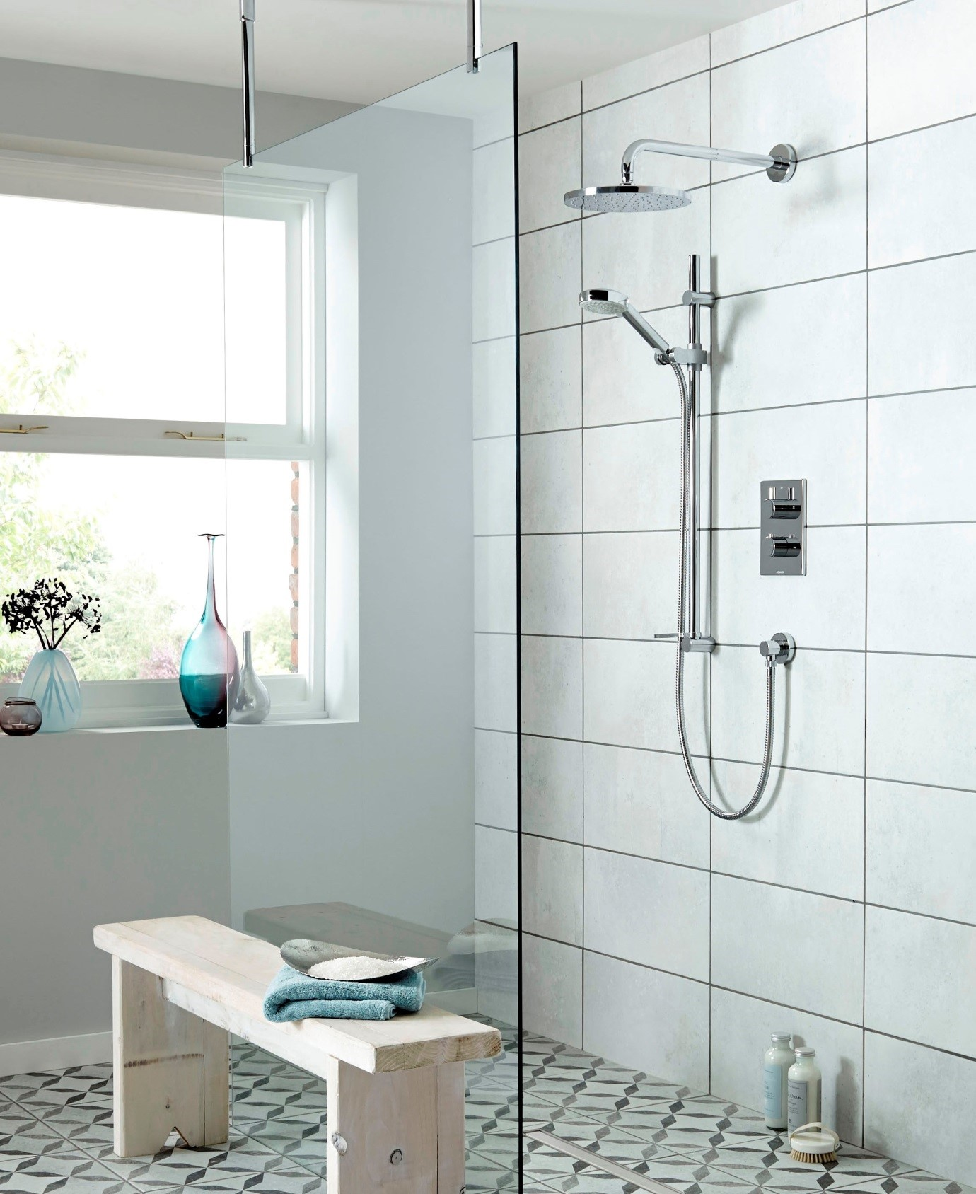 Aqualisa fixed head and shower kit with riser available from BATHLINE bathrooms.
